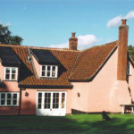 Side elevation showing the two storey extension with the cat-slide dormer windows.