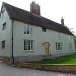 Front elevation showing the new lime render finish